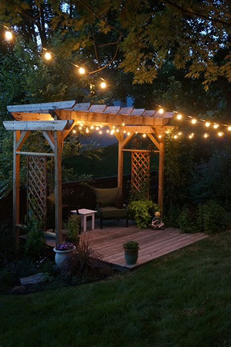 our backyard pergola and string lights our backyard simple decking