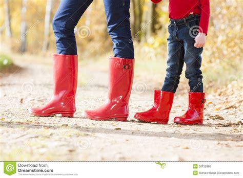 wearing rubber boots wearing rubber boots stock photo image of child