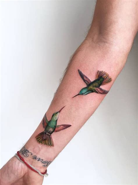fun city tattoo two illustrative hummingbirds on jonni s right inner