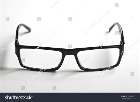 black rimmed reading glasses on white stock photo