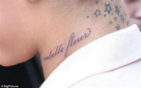 rihanna side tattoo rihanna reveals rebellious side to the world with 15th