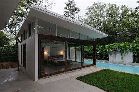 pool house plans with bedroom poolhouse bedroom floor to ceiling windows interior
