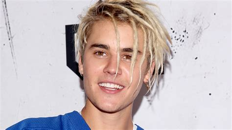 justin bieber s tiny new face tattoo described as