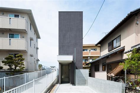 japan skinny house narrow urban home with concrete walls and upper bridge