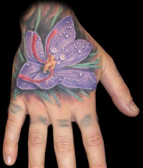 flower tattoo in hand purple flower hand tattoo