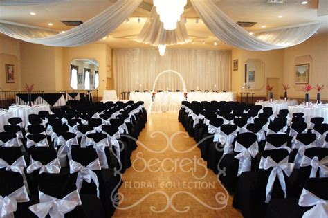 a red black and white ceremony and reception decoration