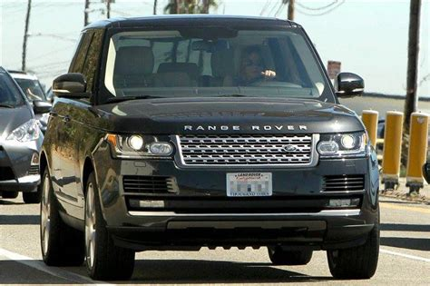 what carpany owns range rover how much money is aniston worth brown hairs