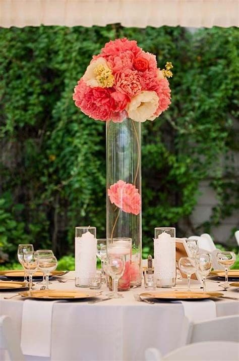 Decorations Tips Balance Bright Pink Peonies Atop A Tall Hurricane Vase Centerpiece Ideas