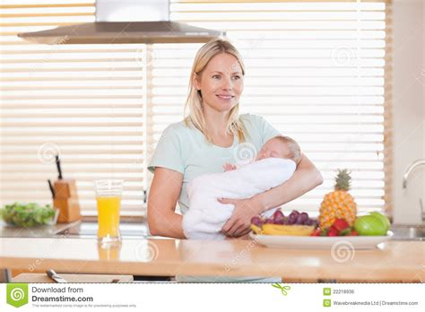 Standing In The Kitchen by Standing In The Kitchen Holding Baby Royalty