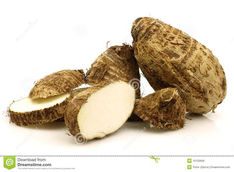 Tropical Root Vegetable - two cut fresh taro root colocasia royalty free stock images image 16103699