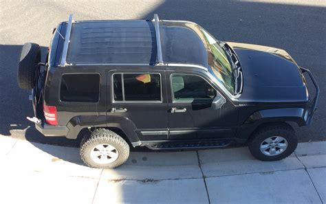 jeep liberty roof roof cross bars for 08 12 jeep liberty kk at the helm