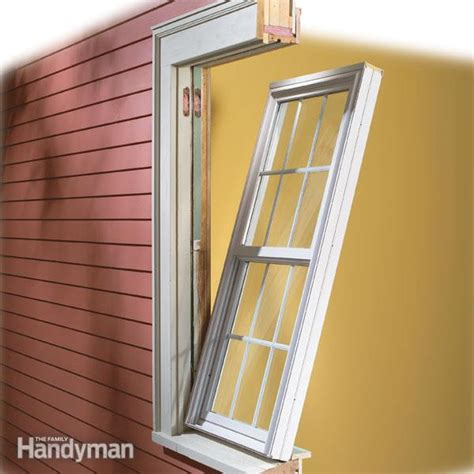how to install windows in house how to install vinyl replacement windows the family handyman