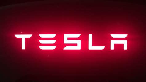 tesla sign tesla s loss grows as elon musk claims customers are