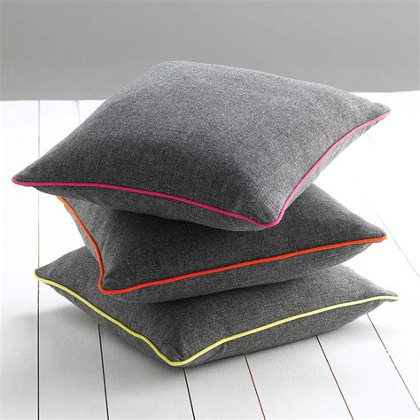 with cusion piped edge cushion by catherine colebrook
