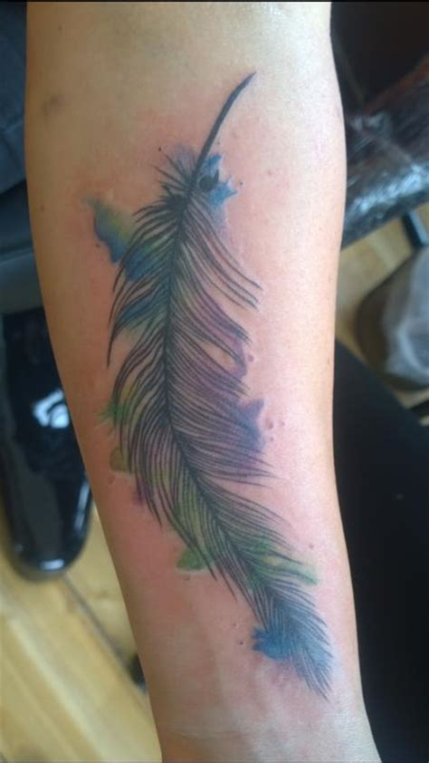 feminine watercolor feather tattoo by chloe deboo tattoos