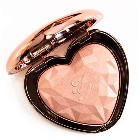 too faced love light highlighter swatches too faced ray of light love light prismatic highlighter