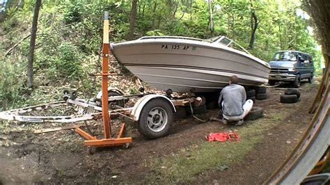 lifting pontoon boat off trailer removing a 19 boat from a trailer on land youtube