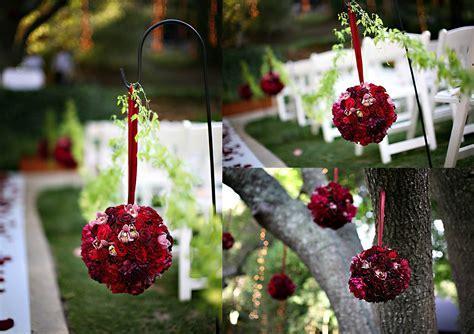 red rose pomander kissing rose balls on shepherd hooks