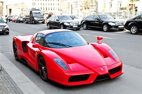 Red Ferrari Enzo by Red Ferrari Enzo On A City Street Wallpapers And Images