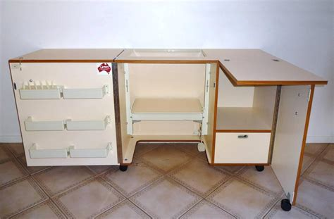 sewing machine cabinets with lift images