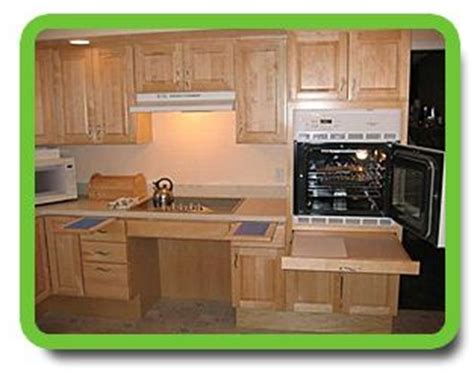 pull kitchen cabinets for the disabled wheel chair accessible cook top and cabinets pull out shelves beside cook top and oven is a