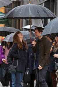jamie dornan when i go dakota johnson and jamie dornan go under umbrella as they