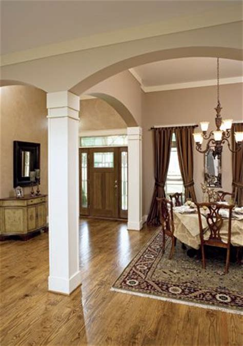 foyer open to dining room craftsman columns columns and arches on