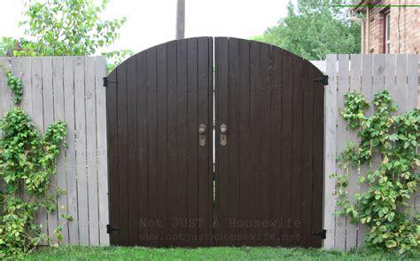 backyard fence door welcome to my secret garden not just a housewife