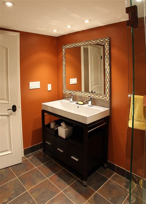 Beautiful burnt orange paint remodeling ideas with clear glass shower dark wood vanity