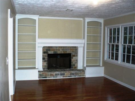 bookcases around fireplace originally a brick wall with the tiny fireplace in