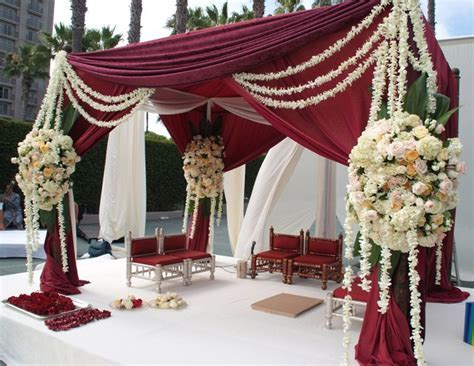 Burgundy and cream mandap decor.   Burgundy and Cream