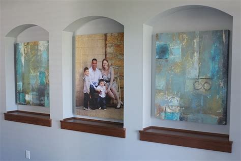 foyer niche family portrait and abstract in the foyer teal and