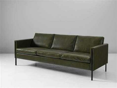 paulin reupholstered 442 sofa in green leather for