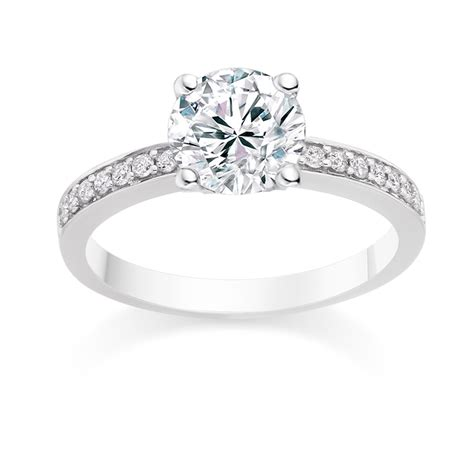 Round Cut 0.75 Carat Side Stones Engagement Ring in 18k