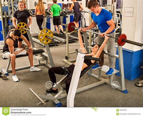 work bench press fitness friends workout gym woman working on bench press