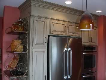 Blend the soffits in with crown molding and paint the