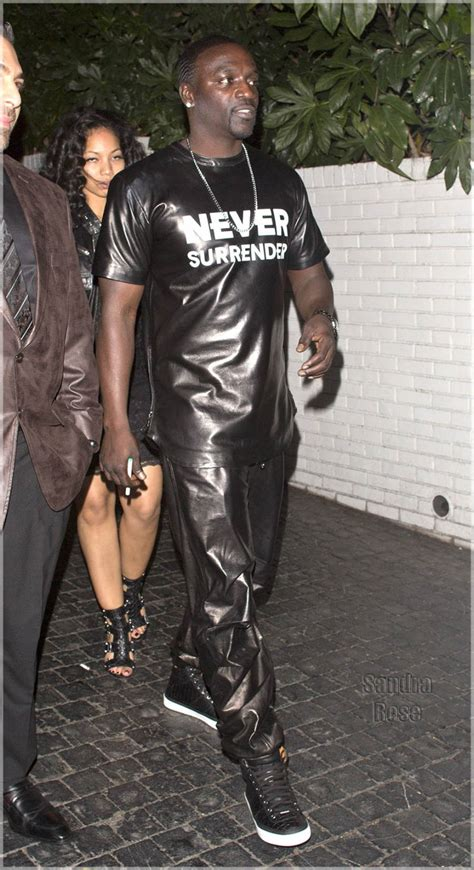 chanel iman diet and exercise rapper akon wearing a full pvc outfit was seen leaving the