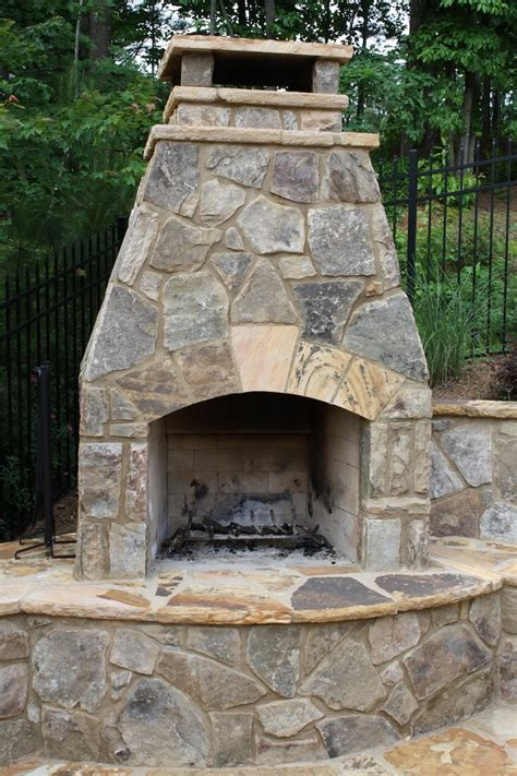 rustic outdoor fireplace with hearth fireplaces and