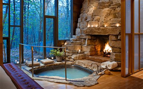 hotel with fireplace fireplace tub and view in vermont hotel room
