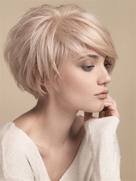 rounded layer haircuts short round layers side swept bangs short hair