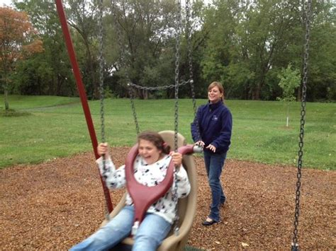 pushing a swing playgrounds are for everyone innovation trail
