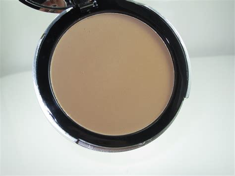E L F Beautifully Bare Sheer Tint Finishing Powder e l f beautifully bare finishing powder clinging to