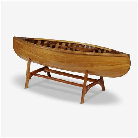 canoe coffee table a coffee table in the form of a carved wood canoe on stand