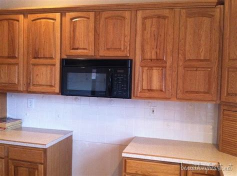 how to paint my kitchen cabinets white painting kitchen cabinets white beneath my heart
