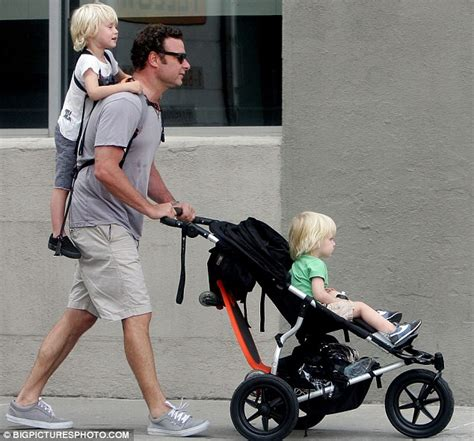 Baby On Board For And Liev by Liev Schreiber Uses Piggyback Rider Contraption To