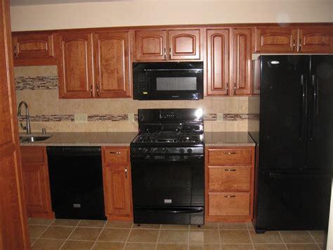 tiles backsplash black l shaped cabinetry with granite l shaped hardwood cabinety gray glass backsplash tile