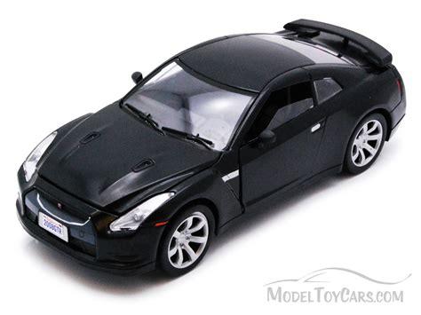 car nissan black nissan gtr black motormax 73384 1 24 scale diecast