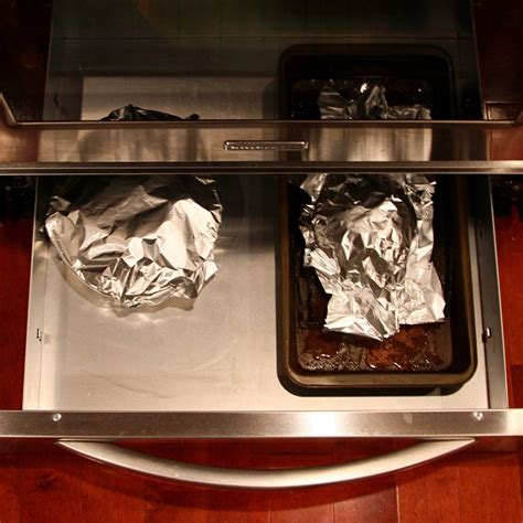 bottom drawer on oven purpose the true purpose of the drawer underneath your oven