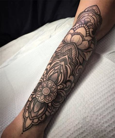 decorative lotus forearm tattoo by laura jade tattoonow