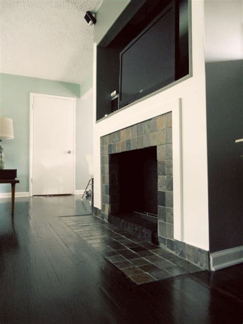 Removing Tile From Fireplace Surround by Fireplace Makeover Removing A Brick Hearth And Retiling